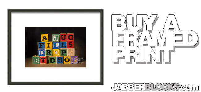 a jug fills drop by drop framed print